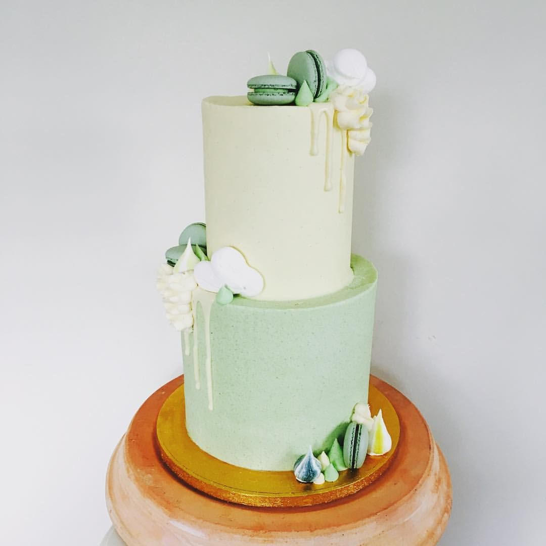 Pale yellow and mint green first birthday cake for baby shower
