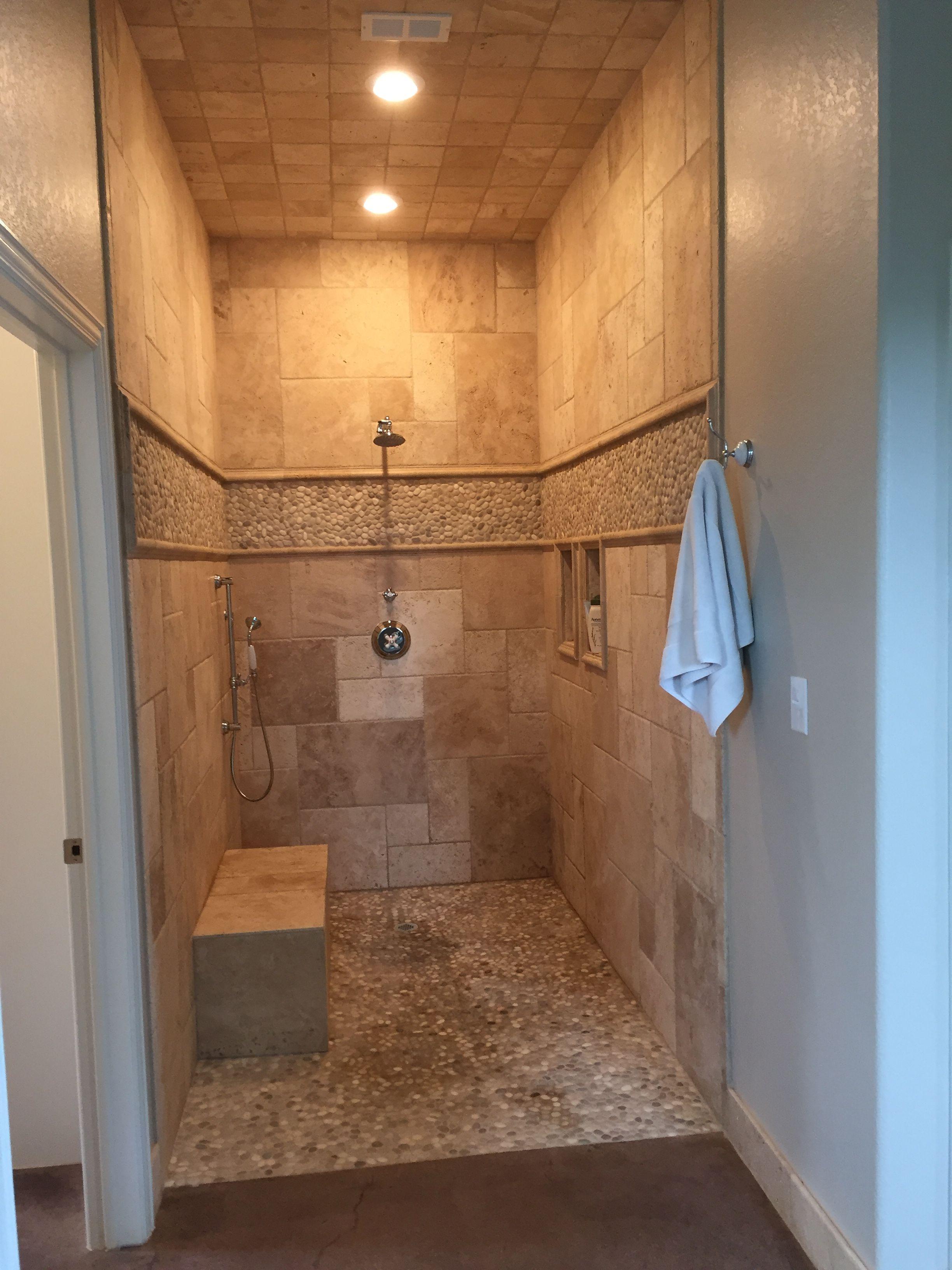 Walk in shower, no door, travertine and pebble tile