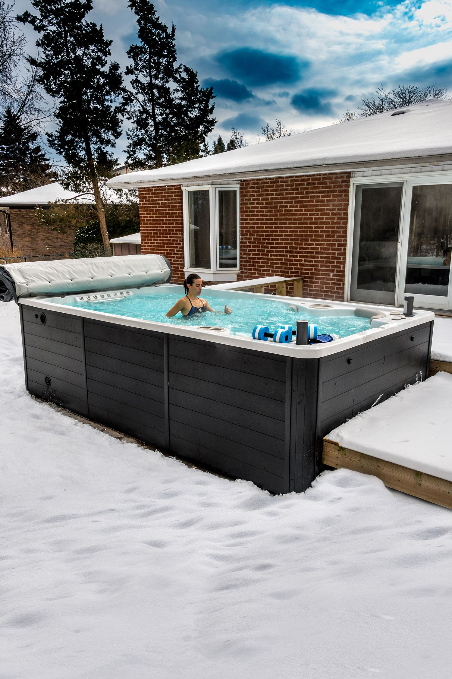 Enjoy Your Swim Spa Year Round By Keeping It Close Your Home Home And Easily Accessible Swim Spa Lap Pools Backyard Hot Tub Swim Spa