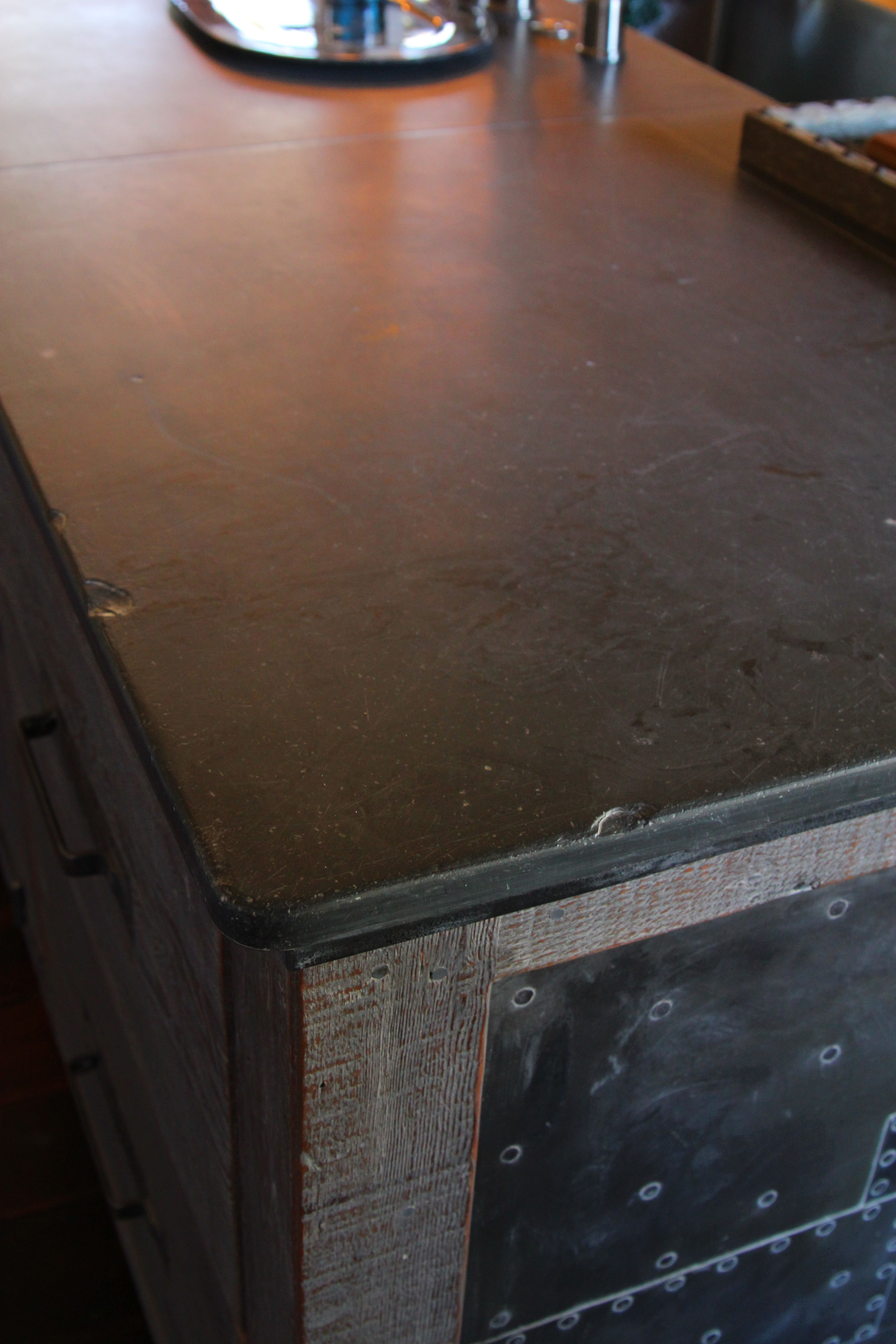 Counter tops made from reclaimed pool table slate (above
