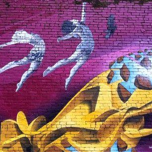 #elikadesigns #hrissa #indigograffiti #vancouver #vancouverstreetart #fashion #abbot #hastings #graffiti top gal is wearing Elika Designs draped halter top. #liveforever