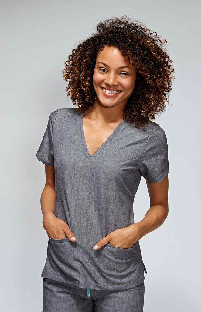 c25f177863c With stretch fabric and three pockets, the women's Casma scrub top is ready  for busy days. Part of FIGS' Technical collection of tailored-fit scrubs.