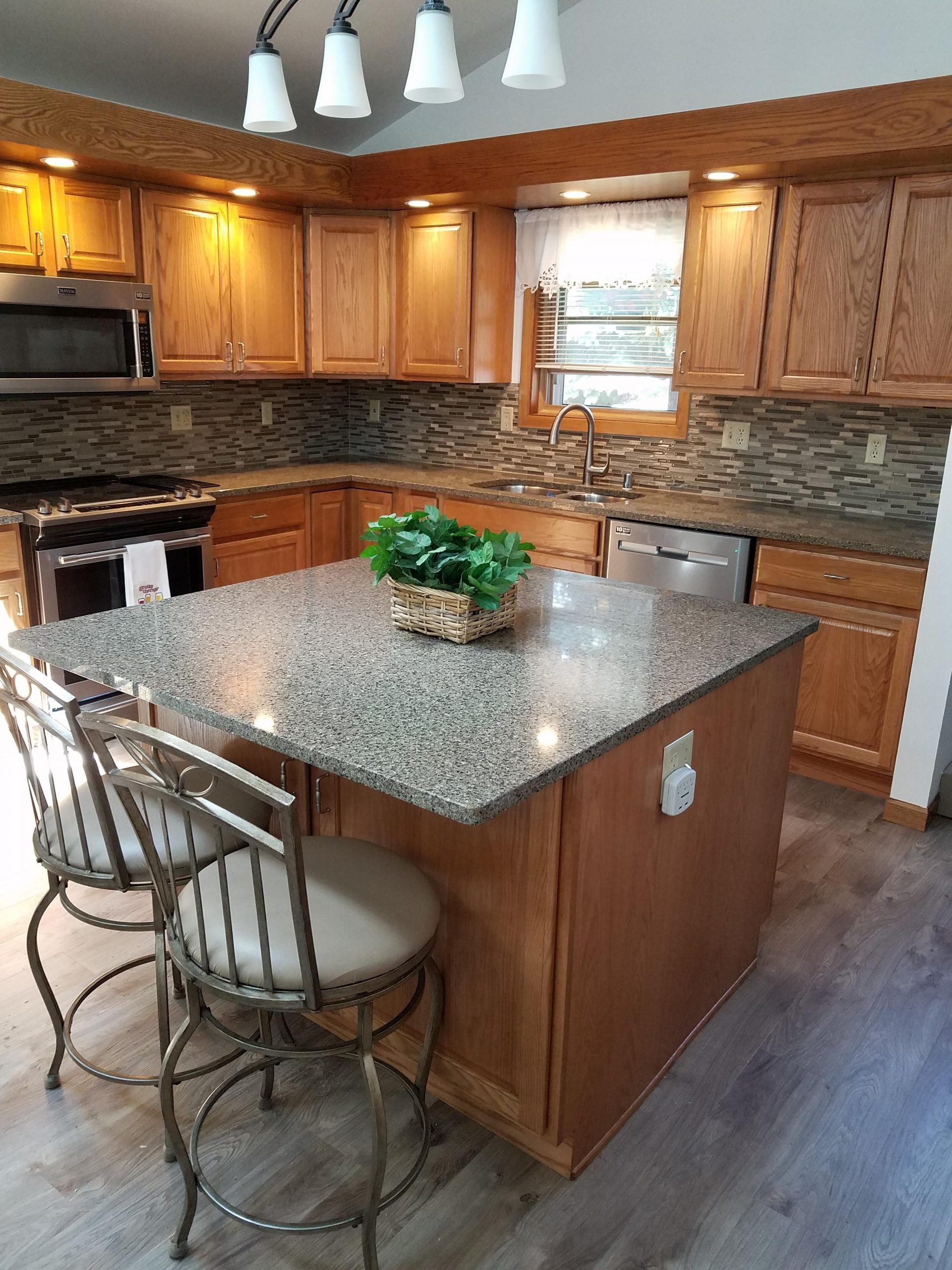 The Warm Toned Merillat Amaretto Oak Cabinets With The Popular Seneca Ridge Door Amaretto Cabinets Door In 2020 Grey Kitchen Floor Oak Cabinets Honey Oak Cabinets