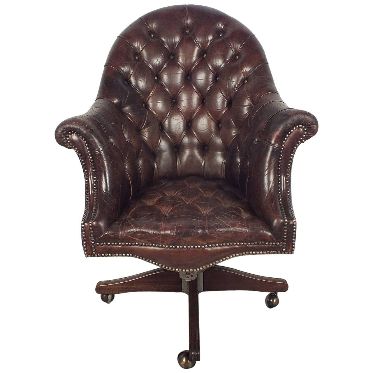 This is a classy 1950s English Chesterfield tufted brown