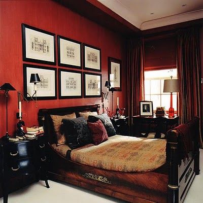 The Rich Red Walls In This Nicolas Haslam Designed Masculine Bedroom Wrap The Room In Warmth Red Bedroom Walls Bedroom Red Best Bedroom Colors