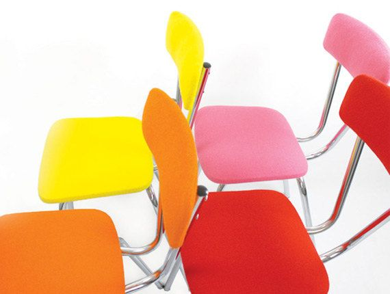 SOLD - 4 dining chairs - pink / orange / yellow / red - steel base. €630.00, via Etsy.
