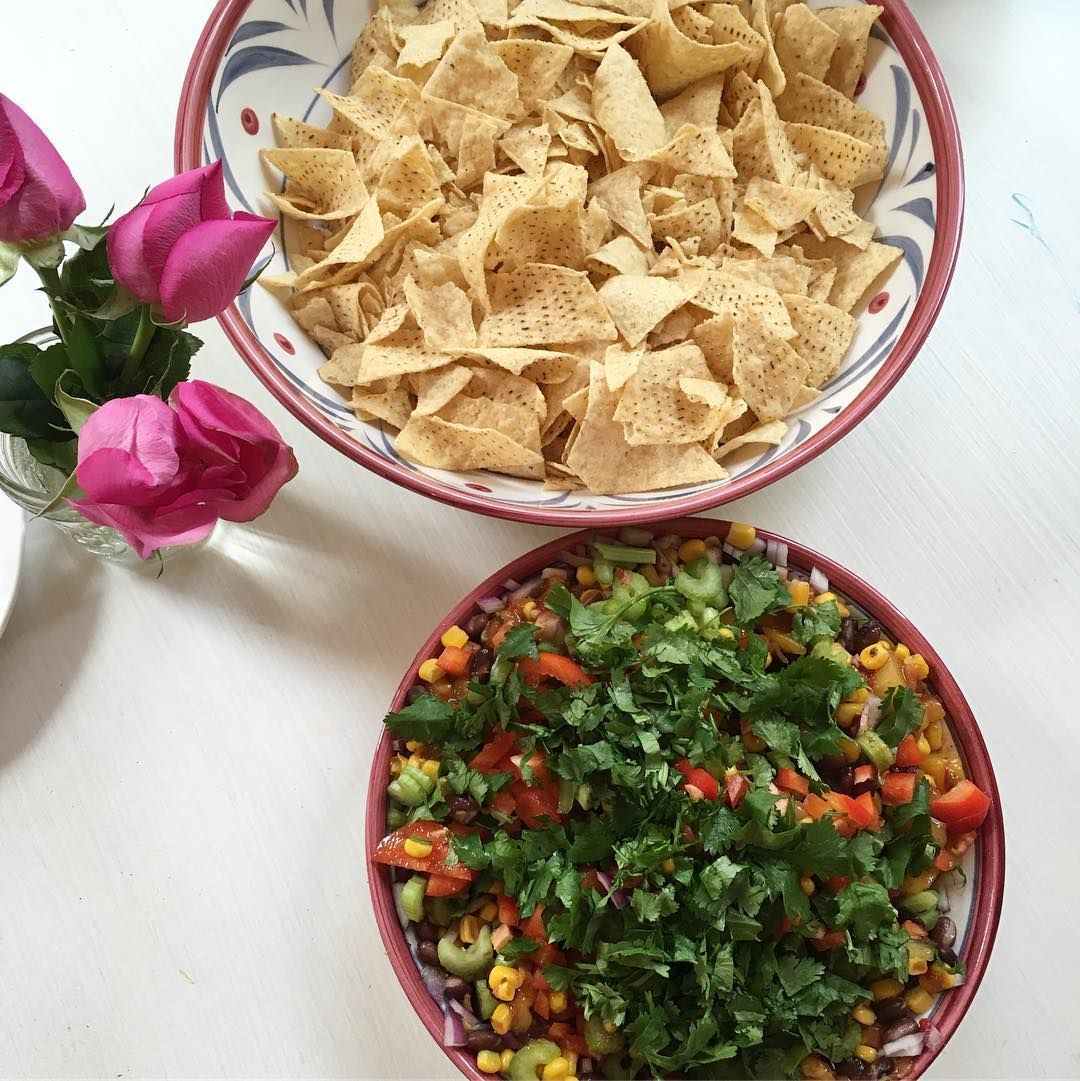 Perfect super bowl Sunday dip. I've been dreaming of making this since my cousin Julie introduced me to it.  Mix together mango pineapple salsa (trader joe's)+ 1 can of organic black beans + 1 can organic corn + 1 small chopped red onion + 4 celery stalks + a chopped red pepper. Top with chopped cilantro and avocado. #glutenfree #fertilitydiet  #ttc #superbowl