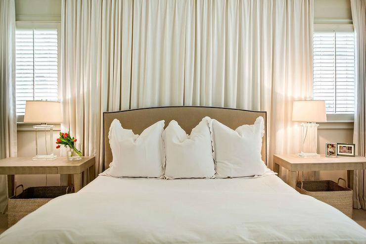 Chic bedroom features camel linen headboard with nailhead trim ...