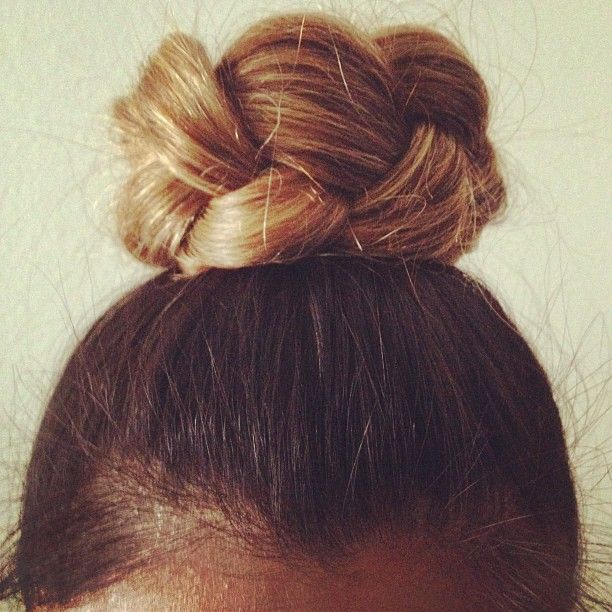 braided bun {tie hair into high pony, then braid, then tie off with a hair thing, then wrap braid around into a bun and secure with a few bobby pins}