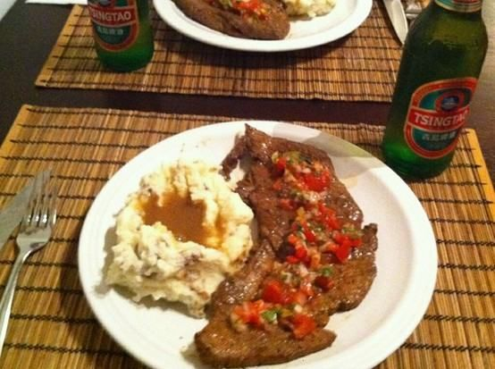 homemade mashed potatoes, steak dressed with a spicy pico de gallo, paired with a cold tsingtao