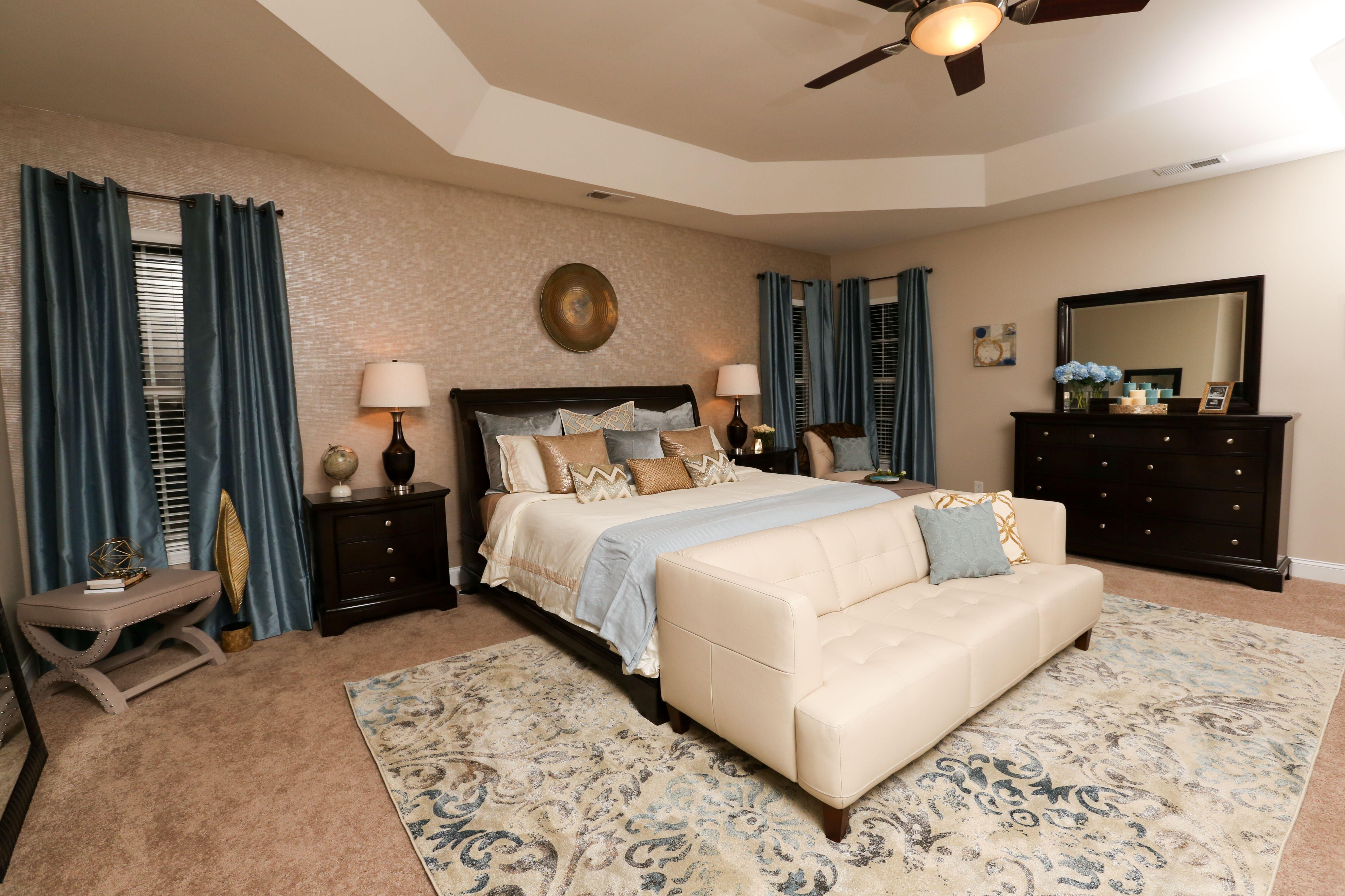 Master bedroom designed in blues, tans, beiges to invoke ...