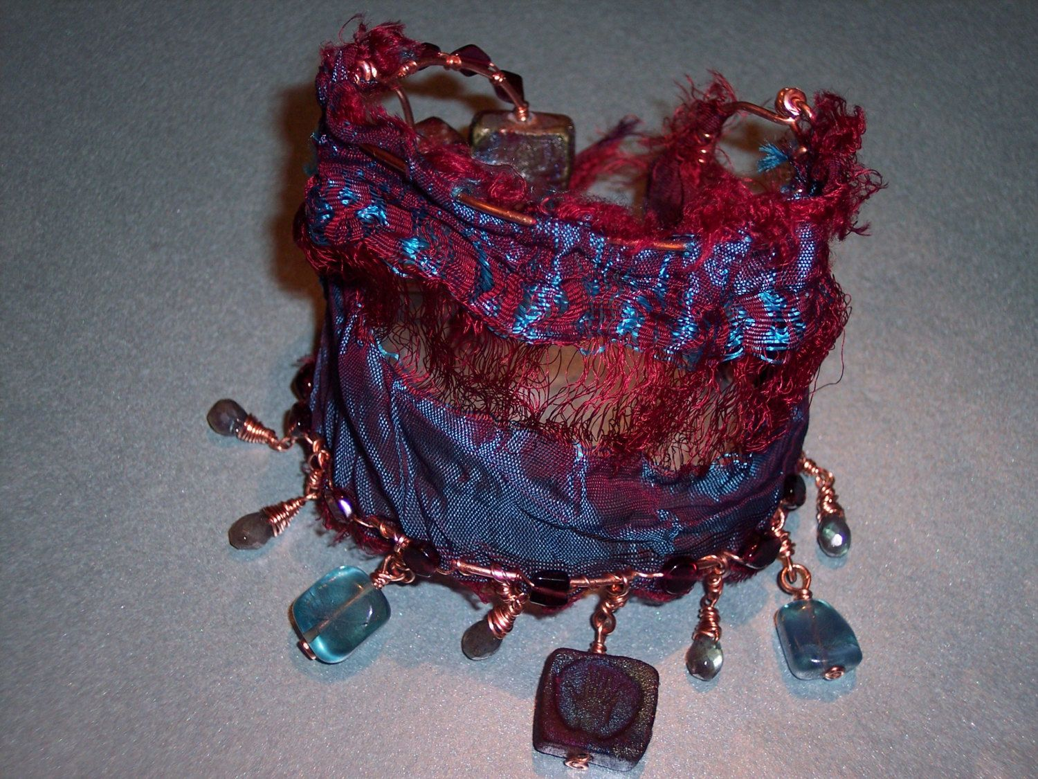 Red Hot and Righteous Blues  upcycled Sari silk and gemstone cuff bracelet. Raku, Labradorite, and Garnet #PyxeeStyx #TravelingSideShow #SRAJD