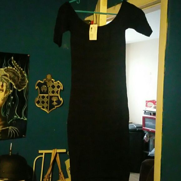 Mid length black dress Brand new everyone's favorite black dress Torn by Ronny Kobo Dresses Midi