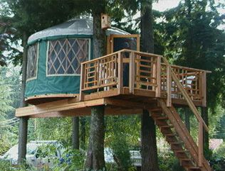 LOVE THIS ONE. a treehouse + a yurt. and practical too ...