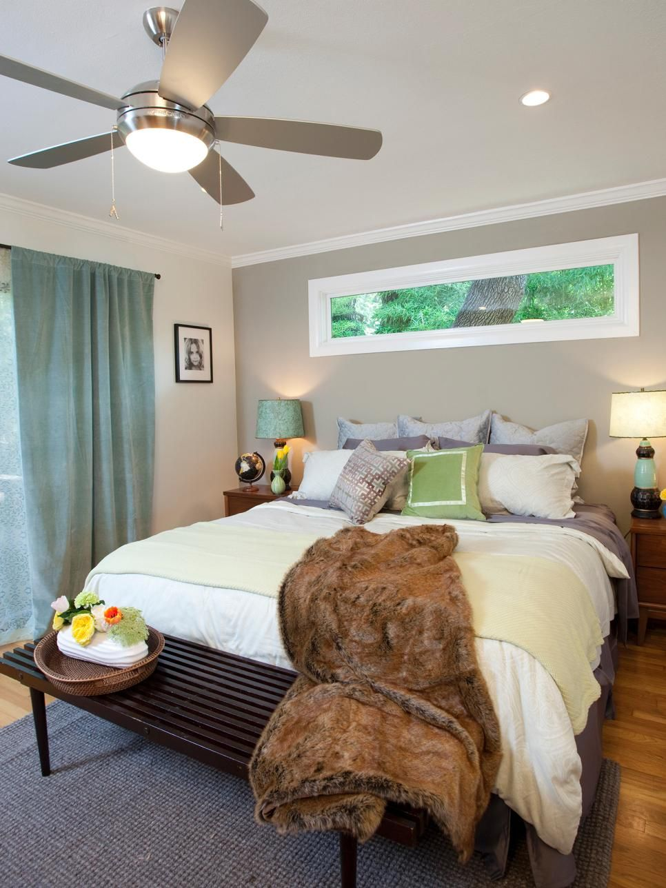 Cool Neutral Paint Colors And Bedding Provide A Tranquil Canvas For This Modern Bedroom Chrome Ceiling Fan Seafoam Green Curtains Faux Fur Throw