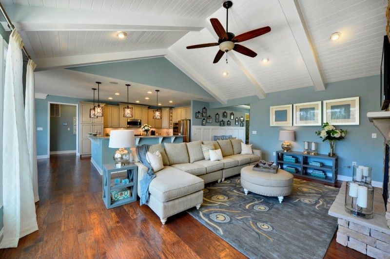 Vaulted Great Room With Kitchen And Living Room Blue Walls Bue Rug Blue Shelves Blue Si Blue Living Room Blue Dining Room Decor Vaulted Ceiling Living Room #vaulted #ceiling #living #room #and #kitchen