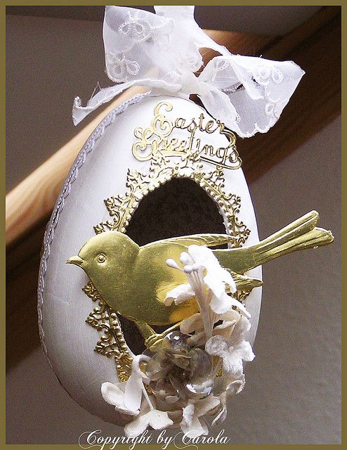 from a bird house egg which I made out of one of my papier maché eggs.