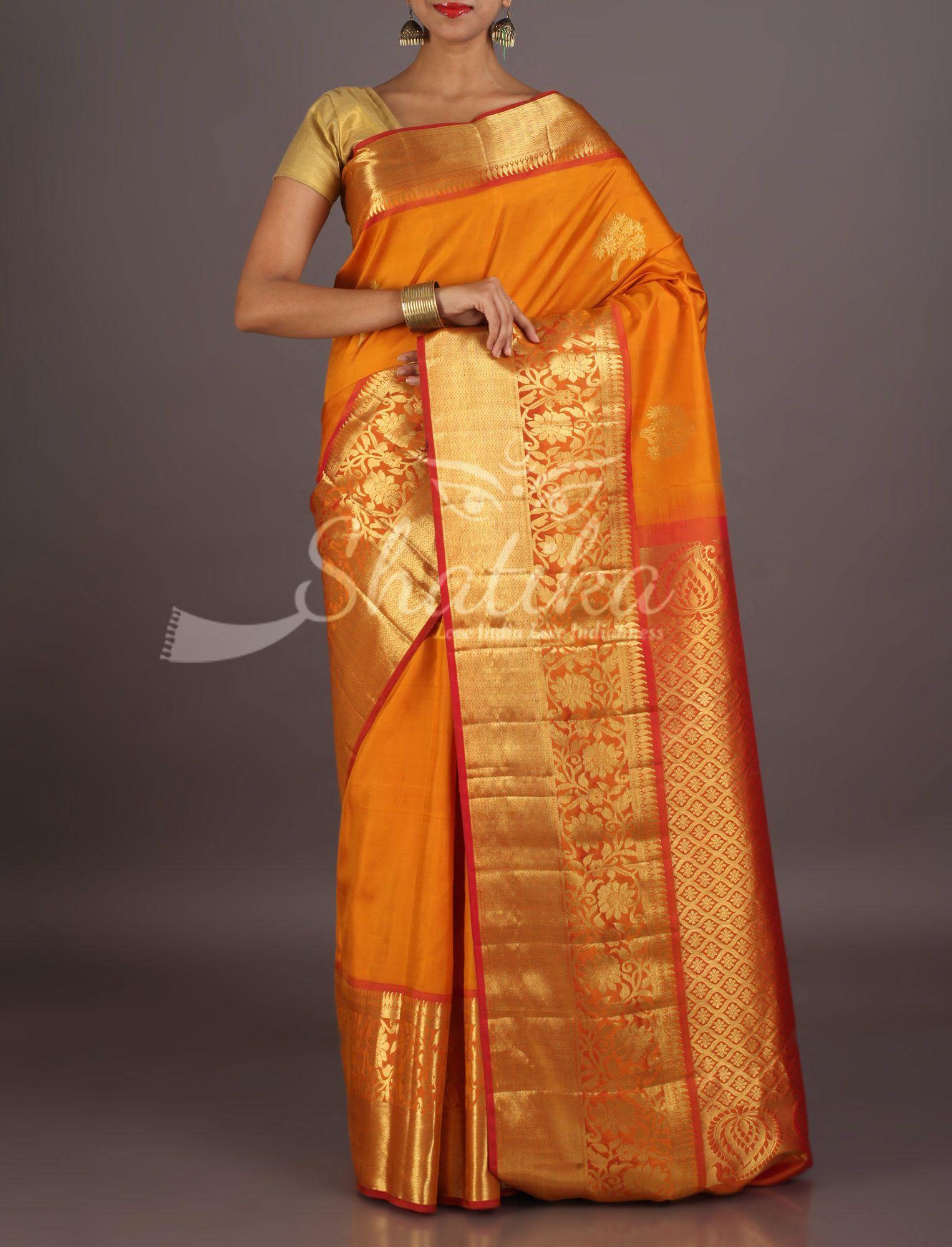 747491f21c61e Madhavi Gold Spot Orange Dazzling Broad Gold Border Pallu Gadwal Silk Saree
