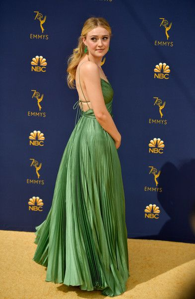 b61bd767b4c Dakota Fanning attends the 70th Emmy Awards at Microsoft Theater on  September 17
