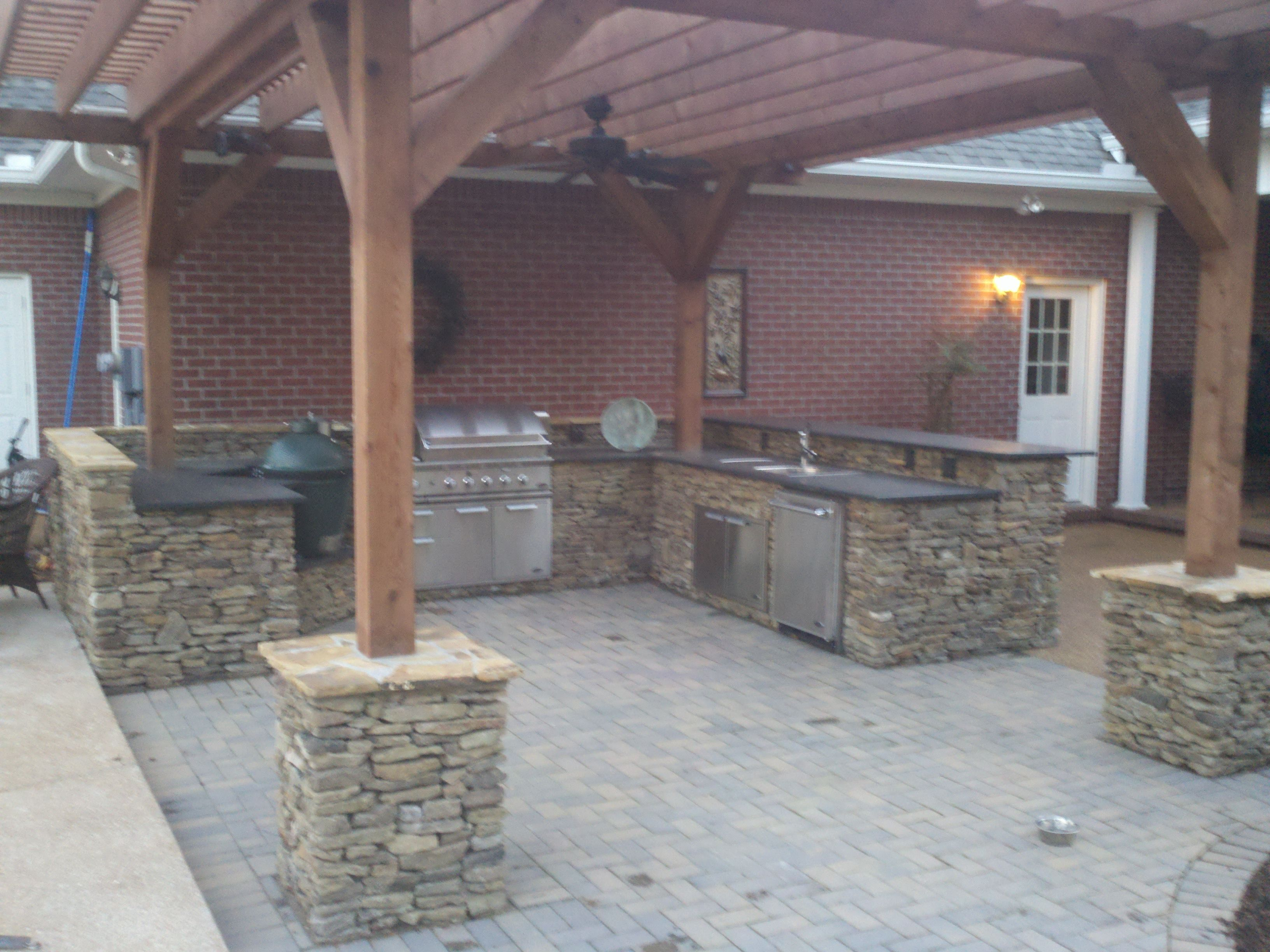 A True Arkansas Field Stone Outdoor Kitchen With Cedar Pergola, Dcs  Appliances, And A Big Green Egg By AMP Landscaping