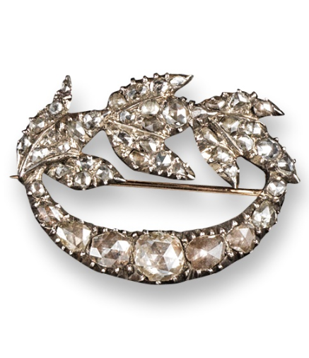 A George III diamond set foliate brooch, set overall with rose-cut diamonds in silver and gold. Closed back mount. 3.5cm wide. Case by Reed of Jermyn Street.