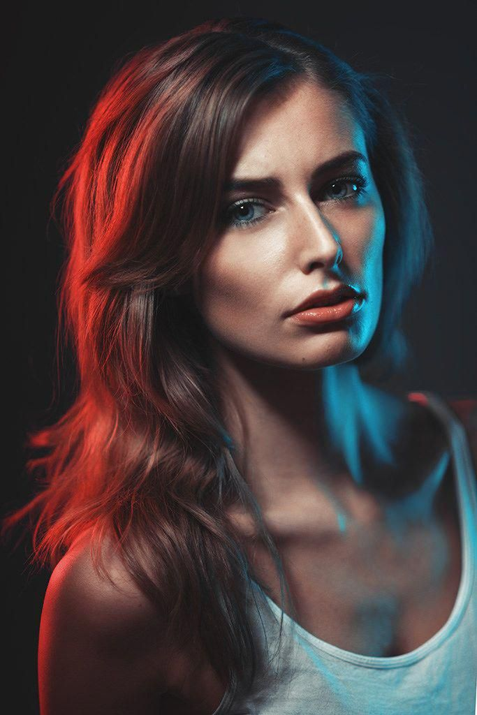 Nikon D800, Nikkor 135mm f/2 2x large stripboxes on either side of the model with colour gels on, as main 40cm beauty dish with grid in front left of …