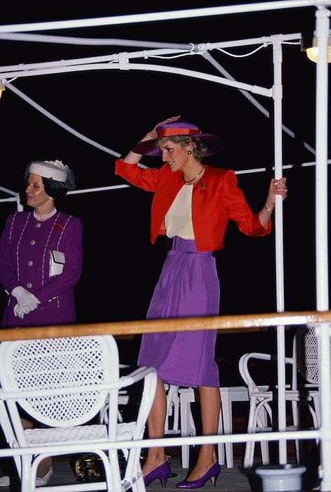 November 7, 1989 Diana holds on to her hat aboard the Governor's yacht for their trip across the harbour for an Arrival Ceremony in Hong Kong