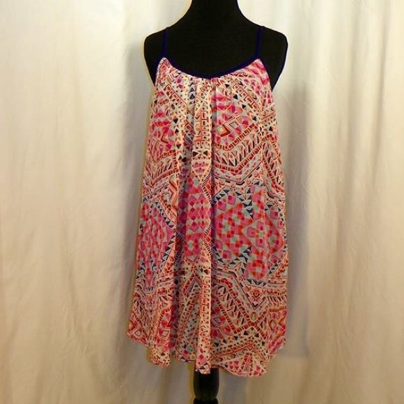 Xhilaration Multicolor Dress Multicolored geometric print tank top dress. It has hot pink, aqua blue, navy blue, orange, red, and light pink designs. 100% Polyester Xhilaration Dresses Mini