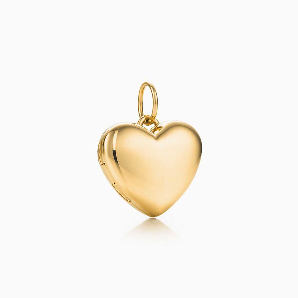 cba22df8b8cc Dije Love en oro blanco y rosa de 18k con diamantes.