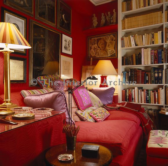 The Walls Of The Small Red Library Are Clad In Scarlet Hand Woven Silk Moire And The Red Sofa Is Covered With Needlepoint Cushions Red Rooms Interior Home