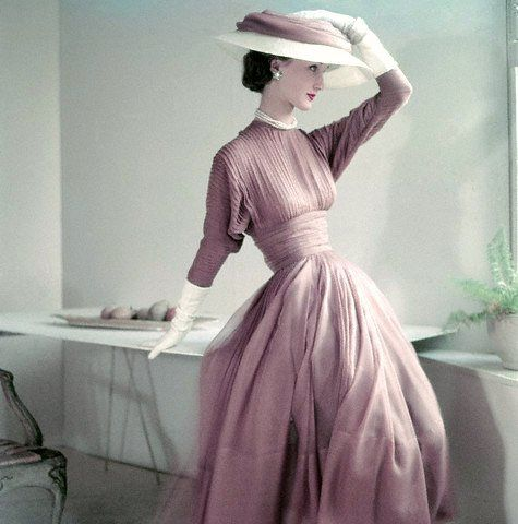 1952, Evelyn Tripp wearing fascia dress in fawn silk muslin, white gloves, and matching hat.