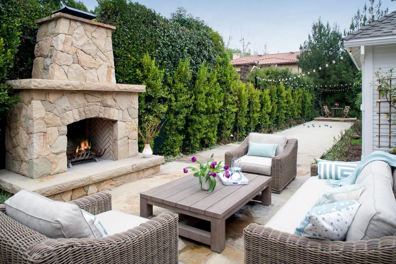Stone Outdoor Living Space With Curved Pergola, Bocce Court
