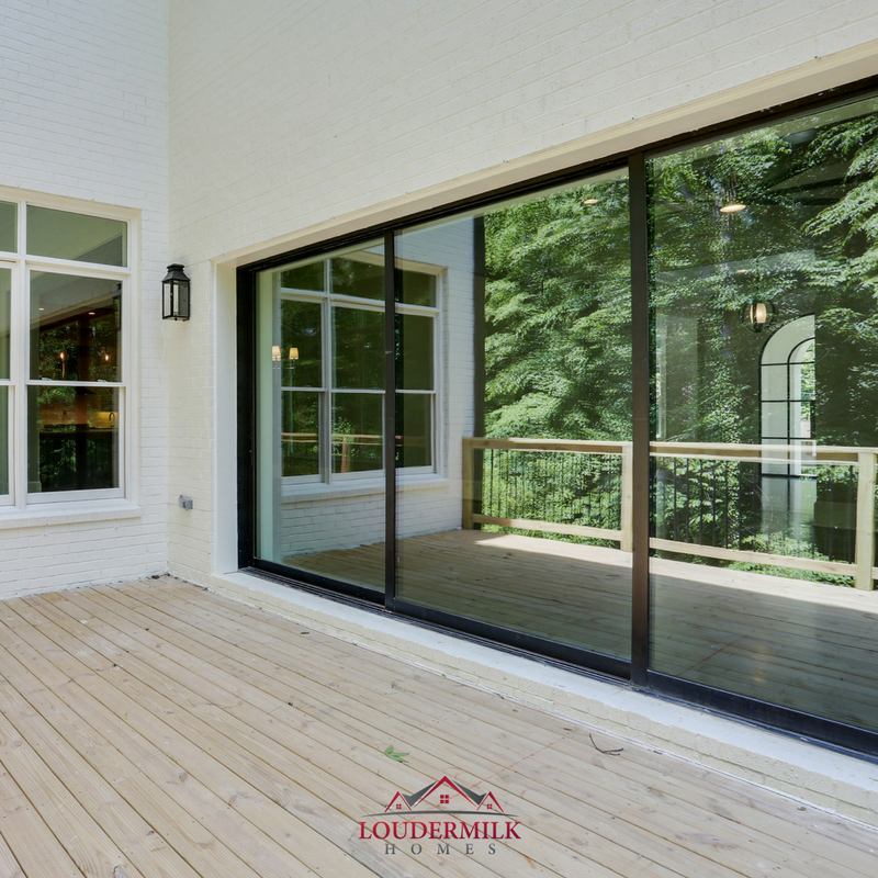 Many Of Our Homes Incorporate The Outdoors With 12 To 15 Foot Sliding Glass Doors That Open To Patios As S Custom Home Builders Sliding Glass Door Custom Homes