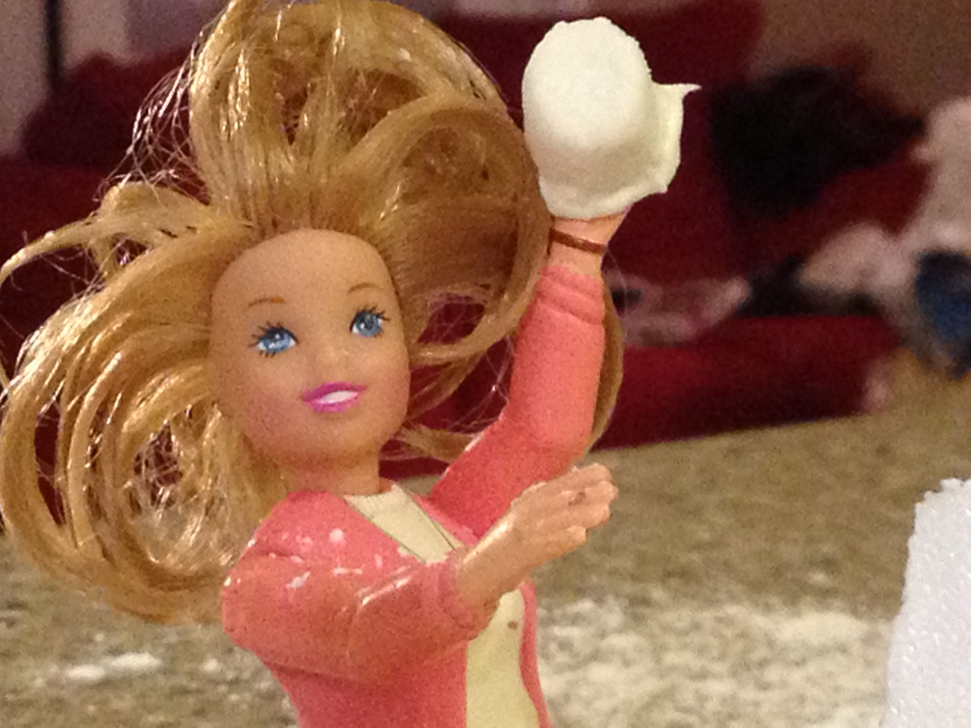Barbie getting ready to hit Glitter with her snowball.