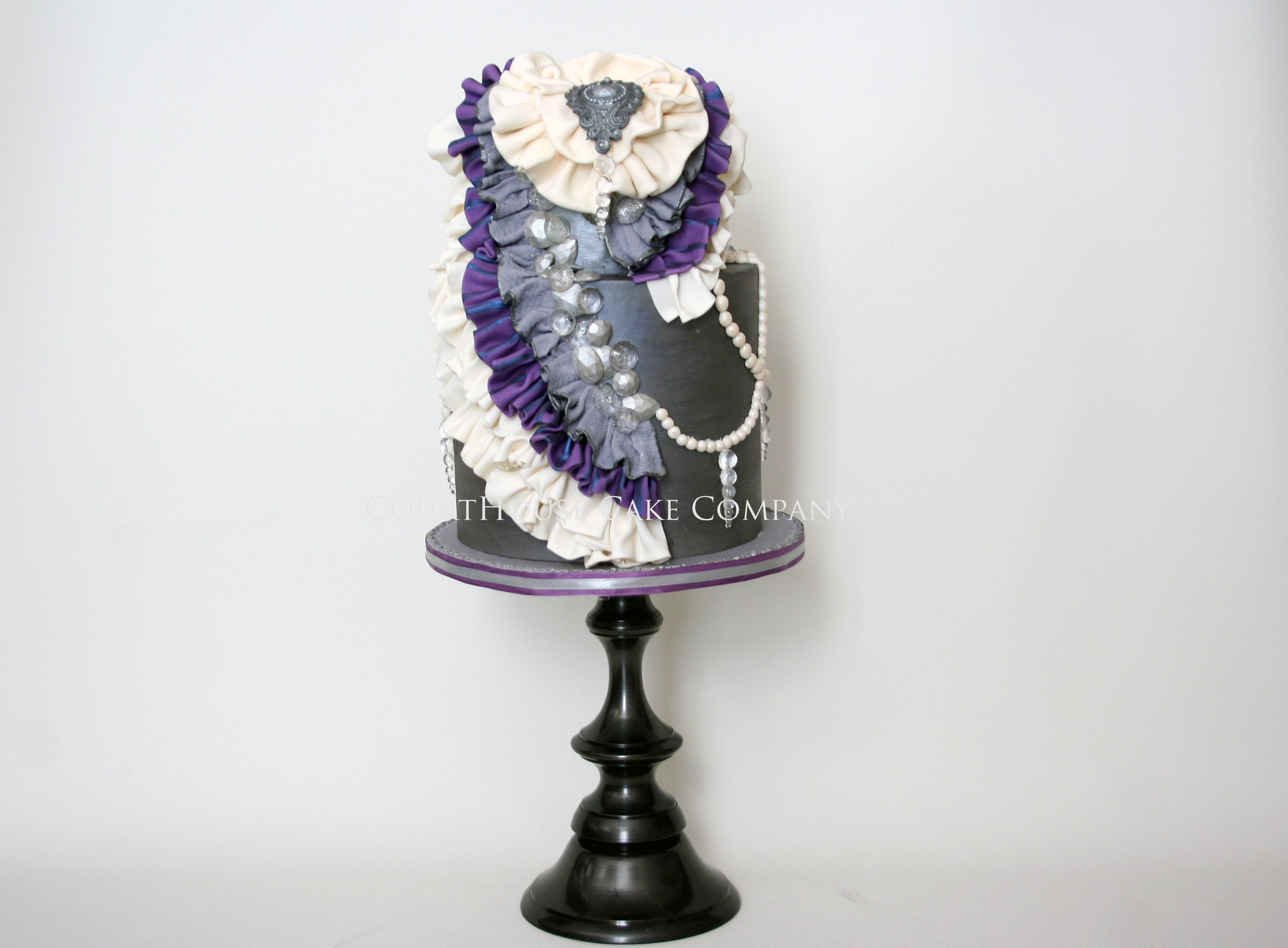 Vintage Ruffles and Gems - Metallic grey cake adorned in Pearls, sugar crystals and fabric inspired ruffles.