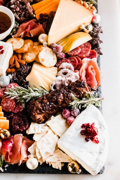 How to Make The Perfect Cheese Board - Cheese boards are perfect for any holiday party or gathering they come together quickly and they're completely customizable! Today I'm sharing all my tips and tricks for creating a delicious stunning cheese board! |