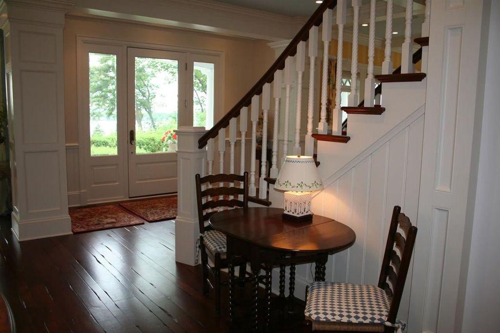 Traditional Entryway with Hardwood floors, Crown molding, High ceiling, Custom Cushions Custom Seat Cushion, Carpet