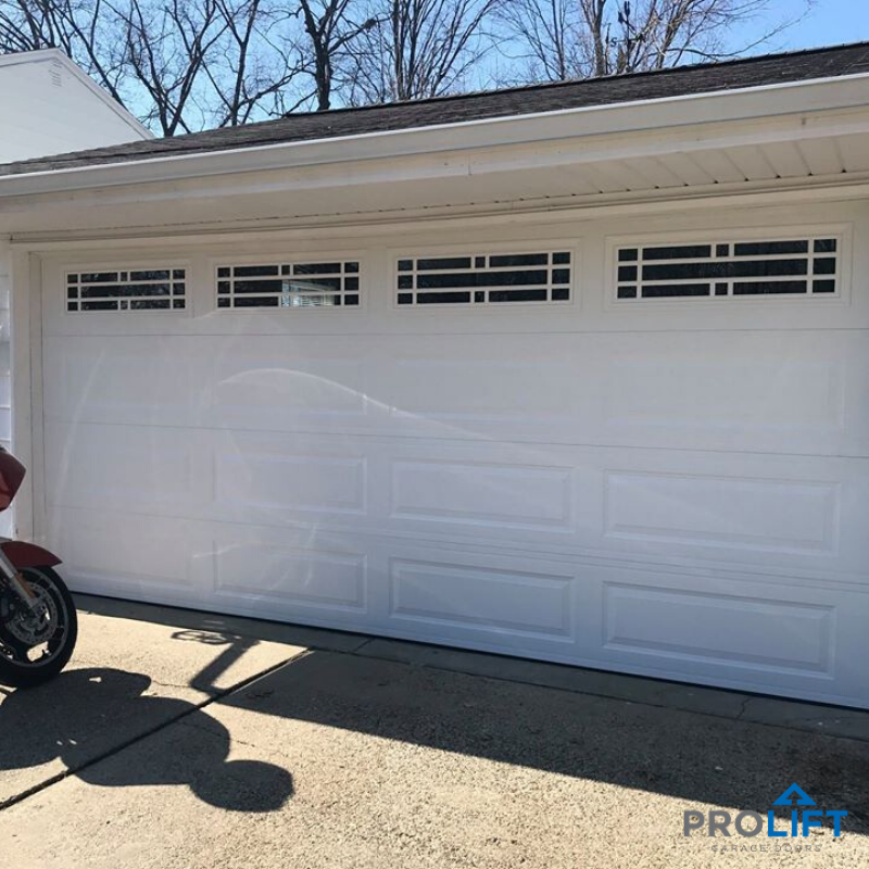 Garage Door With Stylish Windows And Grilles In 2020 Garage Door Design Garage Doors Steel Garage Doors