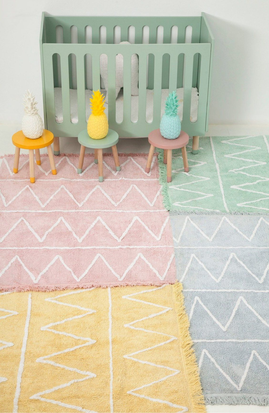 A Zigzag Patterned Pastel Rug Thats Hand Loomed And Trimmed In Fringe