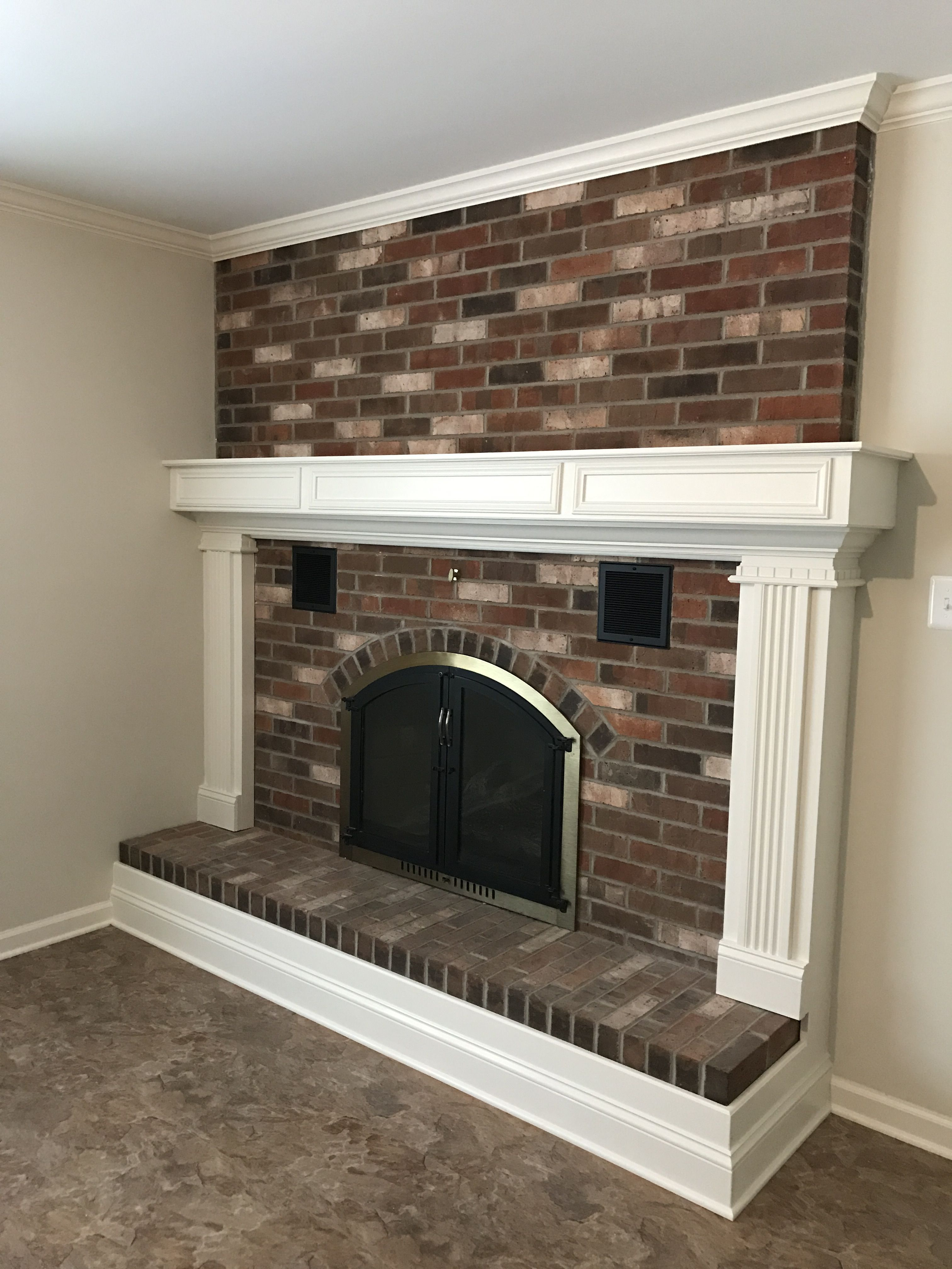 Updated Brick Fireplace With New Surround Trim Around Hearth And Ceiling Crown Molding Fireplace Trim Fireplaces Layout Update Brick Fireplace