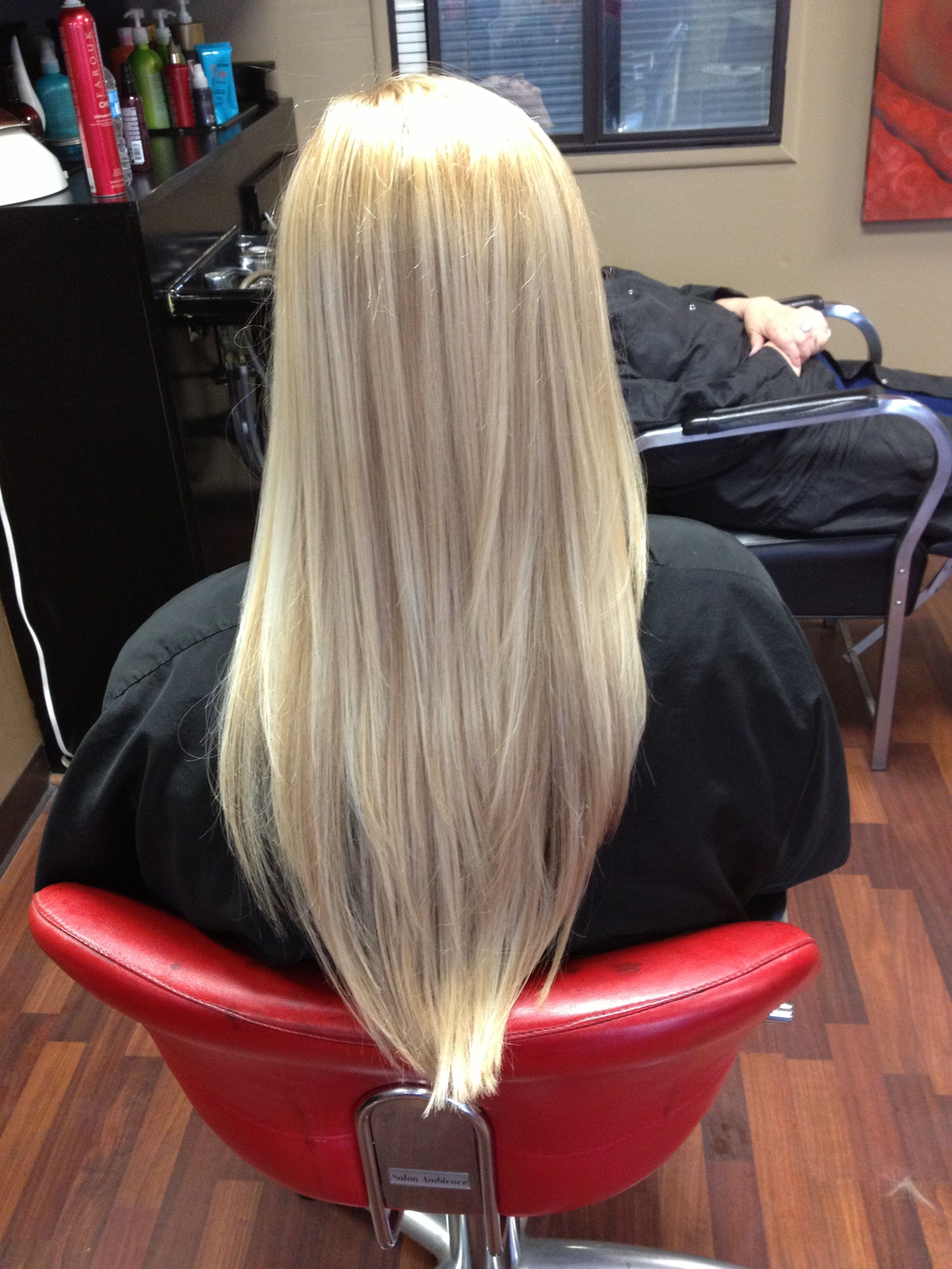 Long Blond Layers Cut Into A V
