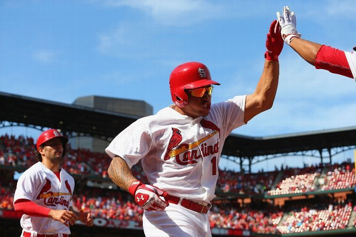 ST. LOUIS, MO - SEPTEMBER 1: Kolten Wong #16 of the St. Louis Cardinals is congratulated after hitting a game-tying solo home run in the sev...