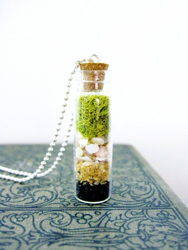 Miniature Nature Inspired Terrarium Pendant with Crushed Shells, Sand, and Lichen Moss & Sterling Silver Necklace. $24.00, via Etsy.