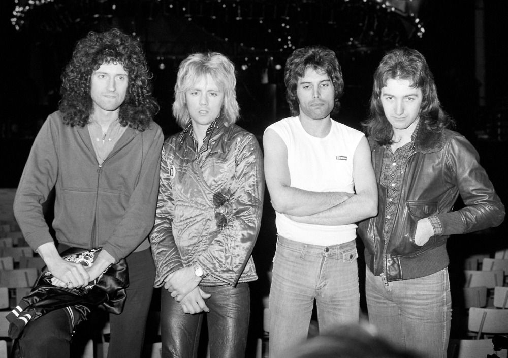 British rock group Queen (From left) Brian May, Roger Taylor, Freddie Mercury and John Deacon at Earls Court, London, where they rehearsed for their up and coming concerts. [collection: 50 Years of…