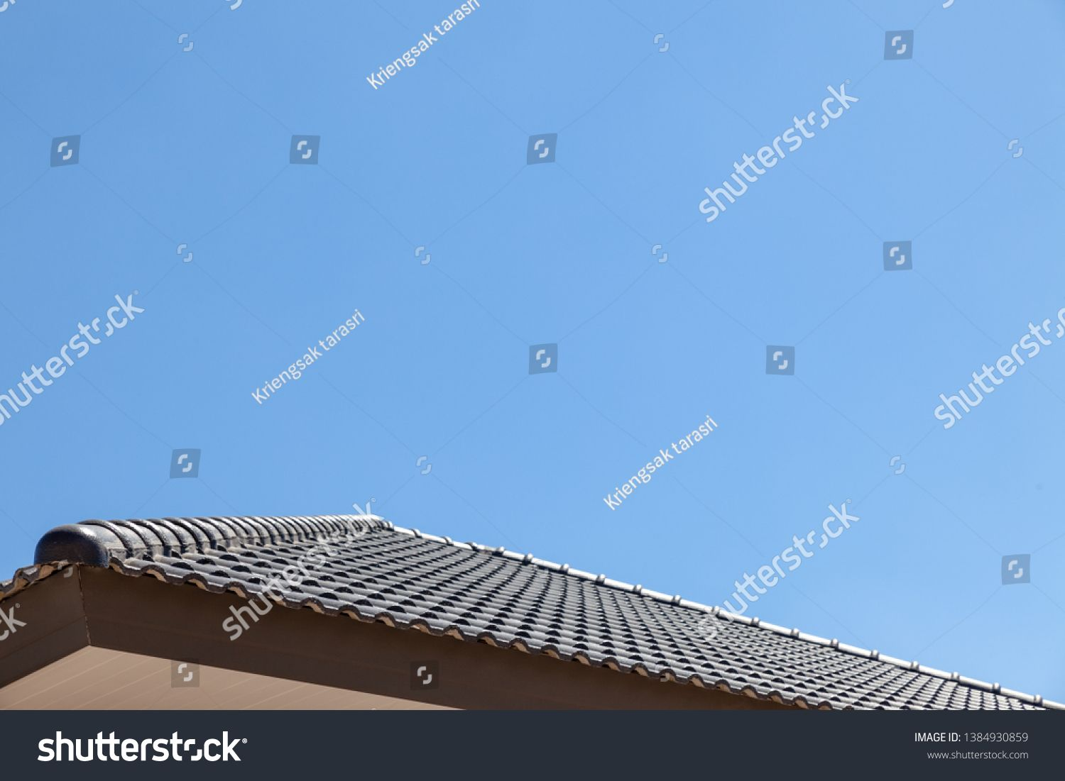 Close up of clay roof tiles Construction equipment house new black roof tiles