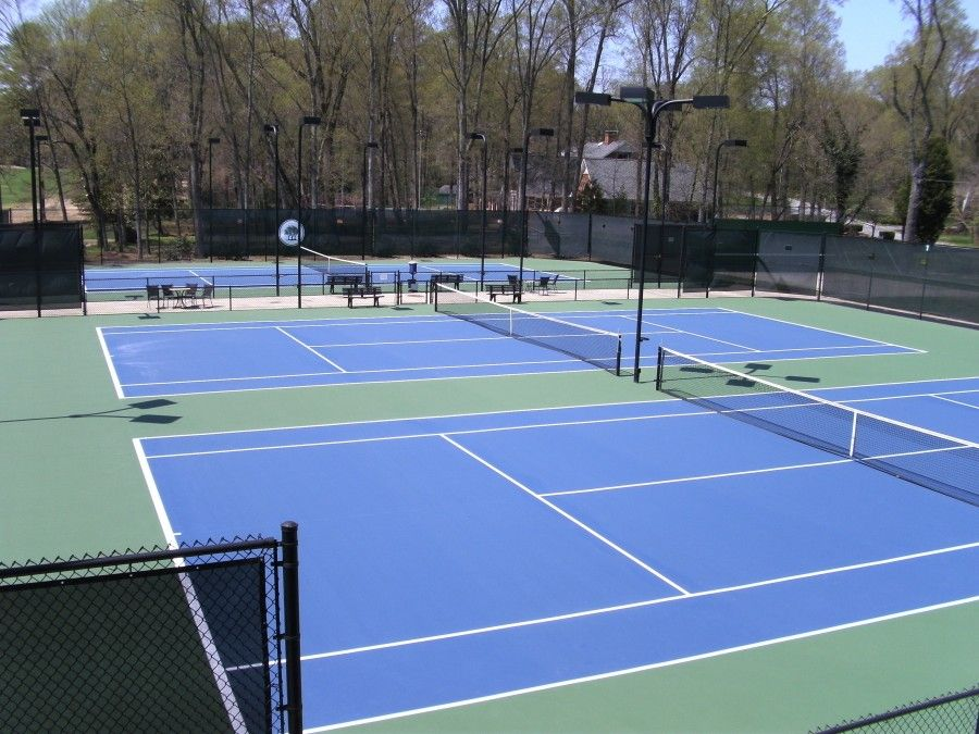 Resurfaced three country club tennis courts in Olympic Blue and US Open  green.