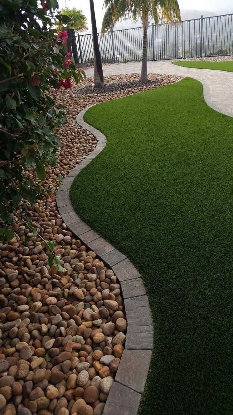 Artificial Turf Stonetop Paver Border Sienna River Rock Side Yard Landscaping Rock Garden Design Landscaping With Rocks