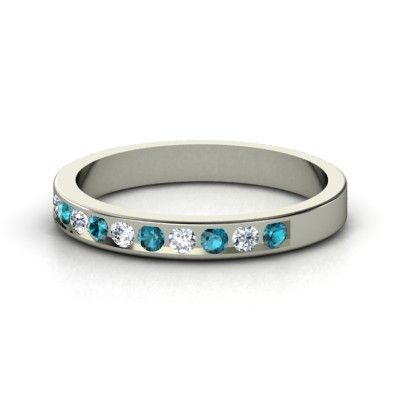 Sterling Silver Ring with Diamond  accent stones: diamond and london blue topaz $455