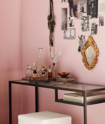 IKEA glass console table and stool holding a collection of glass ...
