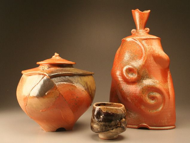 """Shino Jar, 11"""" H x 10"""" W; Japanese Tea Bowl, 4"""" H x 41/2"""" W; Morphed Bottle, 17""""H x 11"""" W. Tom Coleman Henderson, NV. Wheel-thrown and altered porcelain vessels, platters, and sculpture, high-fired to cone 10 in reduction."""